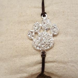 Jewelry - Silvertone Paw Print Cord Bracelet